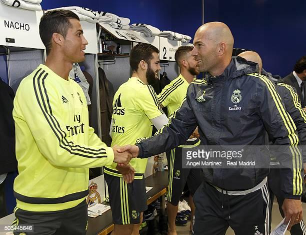 Head coach Zinedine Zidane of Real Madrid greets Cristiano Ronaldo before a training session at Estadio Alfredo Di Stefano on January 5 2016 in...