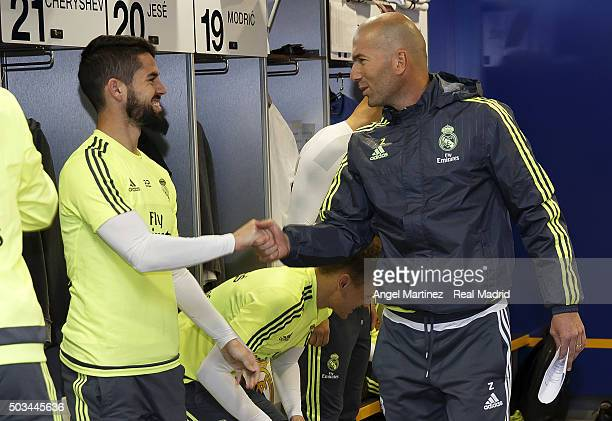 Head coach Zinedine Zidane of Real Madrid greets Isco before a training session at Estadio Alfredo Di Stefano on January 5 2016 in Madrid Spain