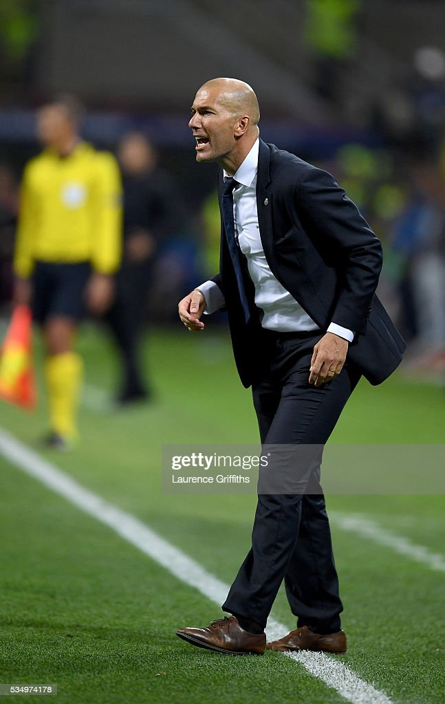 Head coach <a gi-track='captionPersonalityLinkClicked' href=/galleries/search?phrase=Zinedine+Zidane&family=editorial&specificpeople=172012 ng-click='$event.stopPropagation()'>Zinedine Zidane</a> of Real Madrid isuues intructions during the UEFA Champions League Final match between Real Madrid and Club Atletico de Madrid at Stadio Giuseppe Meazza on May 28, 2016 in Milan, Italy.