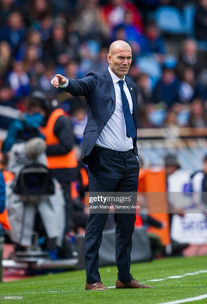 Head coach Zinedine Zidane of Real Madrid reacts during the La Liga match between Real Sociedad de Futbol and Real Madrid at Estadio Anoeta on April 30, 2016 in San Sebastian, .