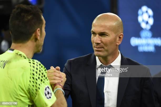 Head coach Zinedine Zidane of Real Madrid shakes hands with Gianluigi Buffon of Juventus after the UEFA Champions League final match between Juventus...
