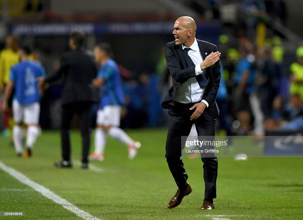 Head coach <a gi-track='captionPersonalityLinkClicked' href=/galleries/search?phrase=Zinedine+Zidane&family=editorial&specificpeople=172012 ng-click='$event.stopPropagation()'>Zinedine Zidane</a> of Real Madrid shows his anger during the UEFA Champions League Final match between Real Madrid and Club Atletico de Madrid at Stadio Giuseppe Meazza on May 28, 2016 in Milan, Italy.