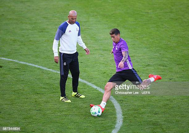 Head Coach Zinedine Zidane of Real Madrid watches James Rodriguez train at Lerkendal Stadion on August 8 2016 in Trondheim Norway