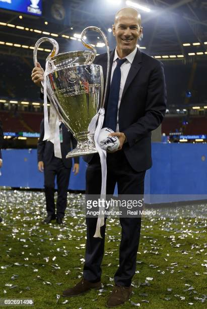 Head coach Zinedine Zidane poses with the Champions League trophy after the UEFA Champions League Final match between Juventus and Real Madrid at...