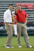 Head coaches Al Golden of the Miami Hurricanes and Randy Edsall of the Maryland Terrapins talk before the start of their game at Byrd Stadium on...