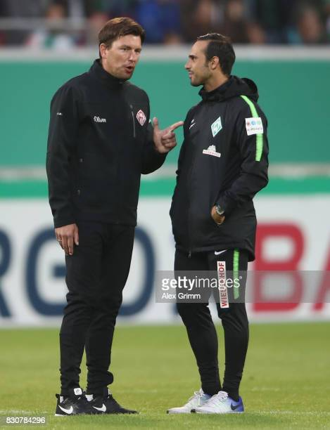 Head coaches Alexander Nouri of Bremen and Stephan Schmidt of Wuerzburg chat prior to the DFB Cup first round match between Wuerzburger Kickers and...