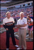 Head coaches Bill Walsh of the San Francisco 49ers and Sam Wyche of the Cincinnati Bengals talk before a 20 to16 victory over the Cincinnati Bengals...
