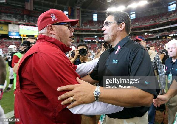 Head coaches Bruce Arians of the Arizona Cardinals and Ron Rivera of the Carolina Panthers shake hands following the NFL game at the University of...
