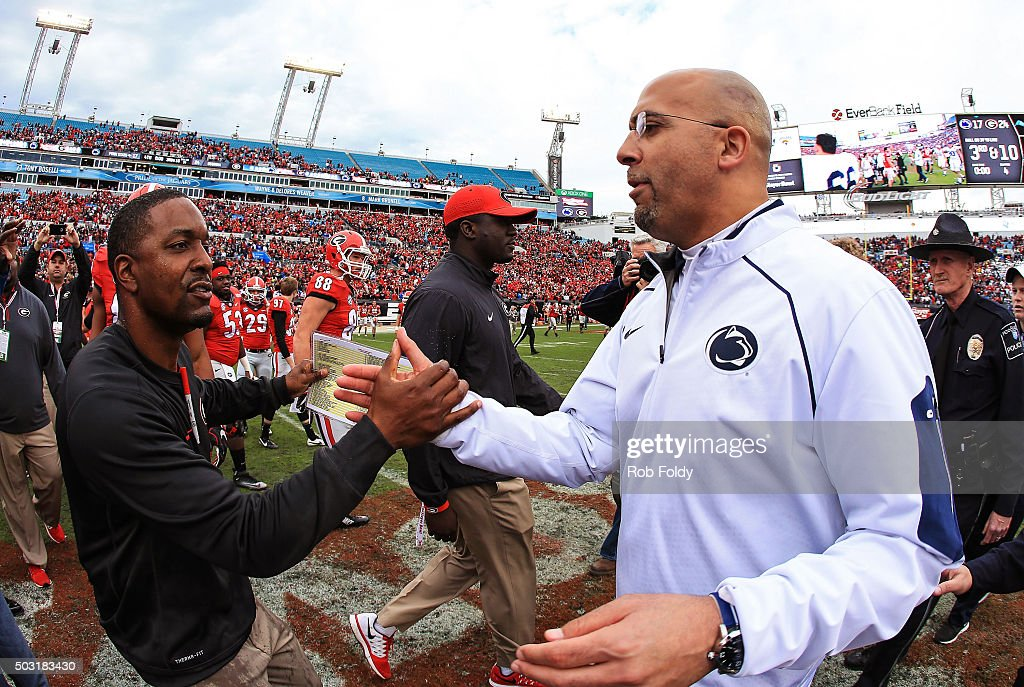 Head coaches <a gi-track='captionPersonalityLinkClicked' href=/galleries/search?phrase=Bryan+McClendon+-+American+Football+Coach&family=editorial&specificpeople=15259356 ng-click='$event.stopPropagation()'>Bryan McClendon</a> of the Georgia Bulldogs and <a gi-track='captionPersonalityLinkClicked' href=/galleries/search?phrase=James+Franklin+-+American+Football+Coach&family=editorial&specificpeople=12333543 ng-click='$event.stopPropagation()'>James Franklin</a> of the Penn State Nittany Lions shake hands after the TaxSlayer Bowl game at EverBank Field between the Georgia Bulldogs and the Penn State Nittany Lions on January 2, 2016 in Jacksonville, Florida.