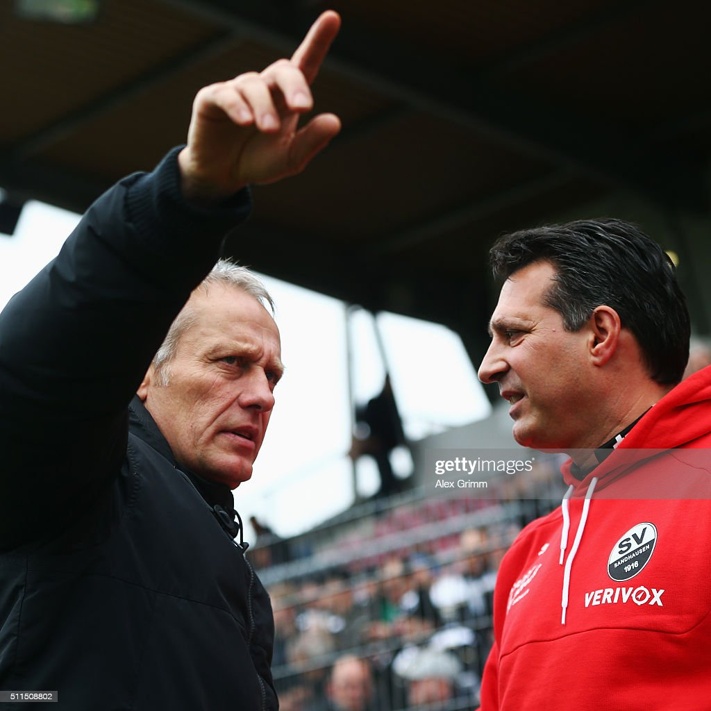 Head coaches <a gi-track='captionPersonalityLinkClicked' href=/galleries/search?phrase=Christian+Streich&family=editorial&specificpeople=4411796 ng-click='$event.stopPropagation()'>Christian Streich</a> (L) of Freiburg and Alois Schwarz of Sandhausen chat prio to the Second Bundesliga match between SV Sandhausen and SC Freiburg at Hardtwaldstadion on February 21, 2016 in Sandhausen, Germany.