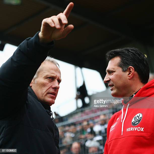 Head coaches Christian Streich of Freiburg and Alois Schwarz of Sandhausen chat prio to the Second Bundesliga match between SV Sandhausen and SC...