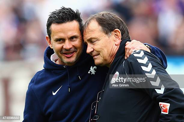 Head coaches Dirk Schuster of Darmstadt and Ewald Lienen of St Pauli hug each other prior to the Second Bundesliga match between SV Darmstadt 98 and...