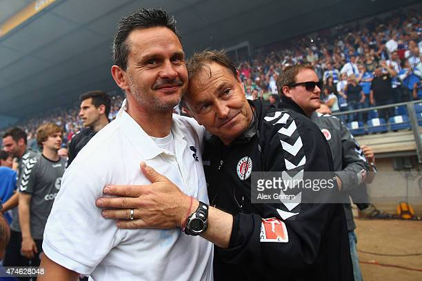 Head coaches Dirk Schuster of Darmstadt and Ewald Lienen of St Pauli celebrate after the Second Bundesliga match between SV Darmstadt 98 and FC St...