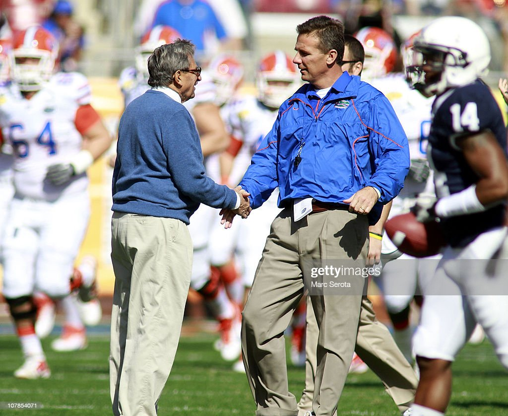 Head coaches Joe Paterno of Penn State (L) greets Urban Meyer of the Florida Gators prior to the Outback Bowl at Raymond James Stadium on January 1, 2011 in Tampa, Florida.