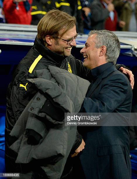 Head coaches Juergen Klopp of Dortmund and Jose Mourinho of Madrid hug prior to the UEFA Champions League Group D match between Real Madrid and...