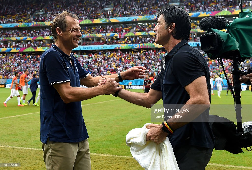 Head coaches <a gi-track='captionPersonalityLinkClicked' href=/galleries/search?phrase=Jurgen+Klinsmann&family=editorial&specificpeople=228023 ng-click='$event.stopPropagation()'>Jurgen Klinsmann</a> (L) of the United States and <a gi-track='captionPersonalityLinkClicked' href=/galleries/search?phrase=Joachim+Loew&family=editorial&specificpeople=215315 ng-click='$event.stopPropagation()'>Joachim Loew</a> of Germany shake hands after the 2014 FIFA World Cup Brazil Group G match between USA and Germany at Arena Pernambuco on June 26, 2014 in Recife, Brazil.