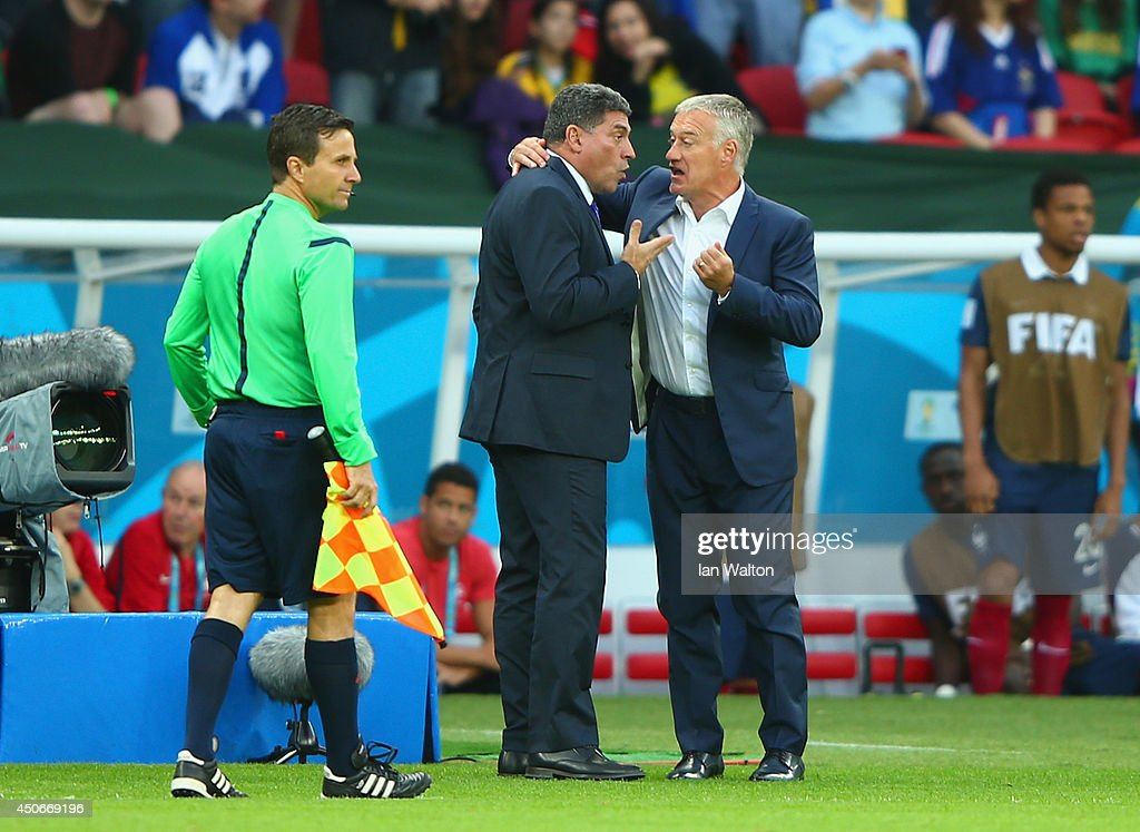 Head coaches <a gi-track='captionPersonalityLinkClicked' href=/galleries/search?phrase=Luis+Fernando+Suarez+-+Fu%C3%9FballtrainerCoach&family=editorial&specificpeople=548216 ng-click='$event.stopPropagation()'>Luis Fernando Suarez</a> of Honduras and <a gi-track='captionPersonalityLinkClicked' href=/galleries/search?phrase=Didier+Deschamps&family=editorial&specificpeople=213607 ng-click='$event.stopPropagation()'>Didier Deschamps</a> of France in discussion after France's second goal during the 2014 FIFA World Cup Brazil Group E match between France and Honduras at Estadio Beira-Rio on June 15, 2014 in Porto Alegre, Brazil.