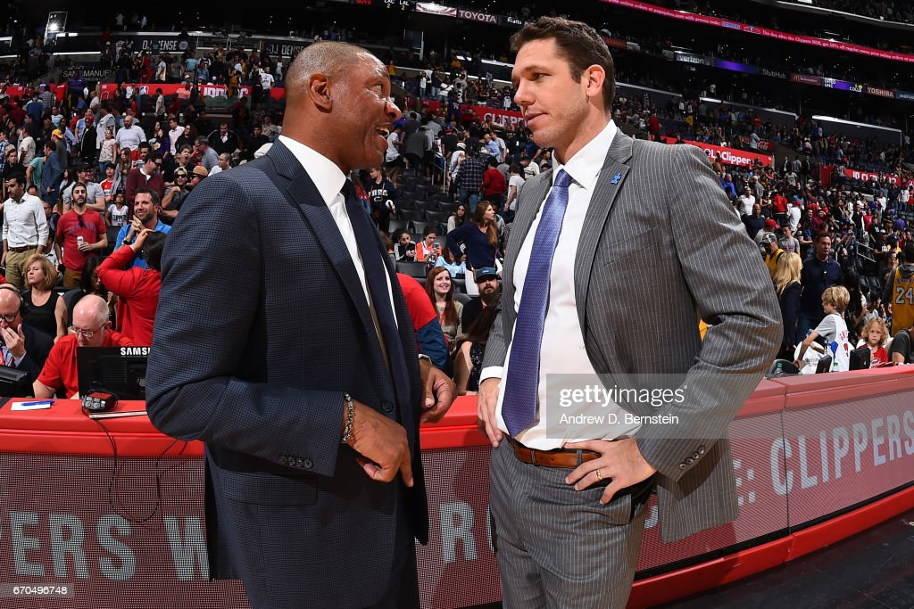 Head Coaches Luke Walton of the Los Angeles Lakers and Doc Rivers of the LA Clippers talk after the game on April 1, 2017 at STAPLES Center in Los Angeles, California.