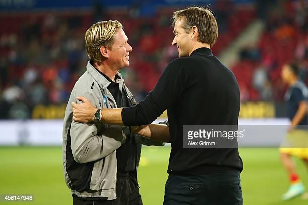 Head coaches Markus Gisdol of Hoffenheim and Kasper Hjulmand of Mainz chat prior to the Bundesliga match between 1 FSV Mainz 05 and 1899 Hoffenheim...