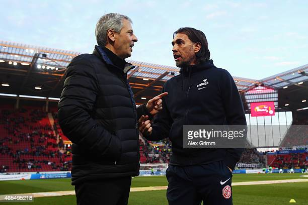 Head coaches Martin Schmidt of Mainz and Lucien Favre of Moenchengladbach chat prior to the Bundesliga match between 1 FSV Mainz 05 and Borussia...
