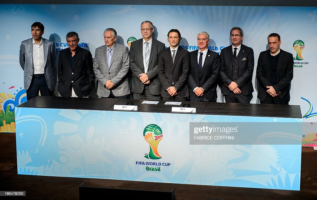 Head coaches of the football national team (L to R) Victor Pitura of Romania, Fernando Santos of Greece, Oleg Fomenko of Ukraine, Lars Lagerbaeck of Iceland, Niko Kovac of Croatia, Didier Deschamps of France, Erik Hamren of Sweden and Paulo Bento of Portugal pose after attending the draw for the 2014 FIFA World Cup European zone play-off matches held at the headquarters of the football's world governing body in Zurich on October 21, 2013. The play-off matches are due to be played on November 15 and 19.