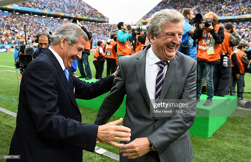 Head coaches Oscar Tabarez of Uruguay and <a gi-track='captionPersonalityLinkClicked' href=/galleries/search?phrase=Roy+Hodgson&family=editorial&specificpeople=881703 ng-click='$event.stopPropagation()'>Roy Hodgson</a> of England talk prior to the 2014 FIFA World Cup Brazil Group D match between Uruguay and England at Arena de Sao Paulo on June 19, 2014 in Sao Paulo, Brazil.