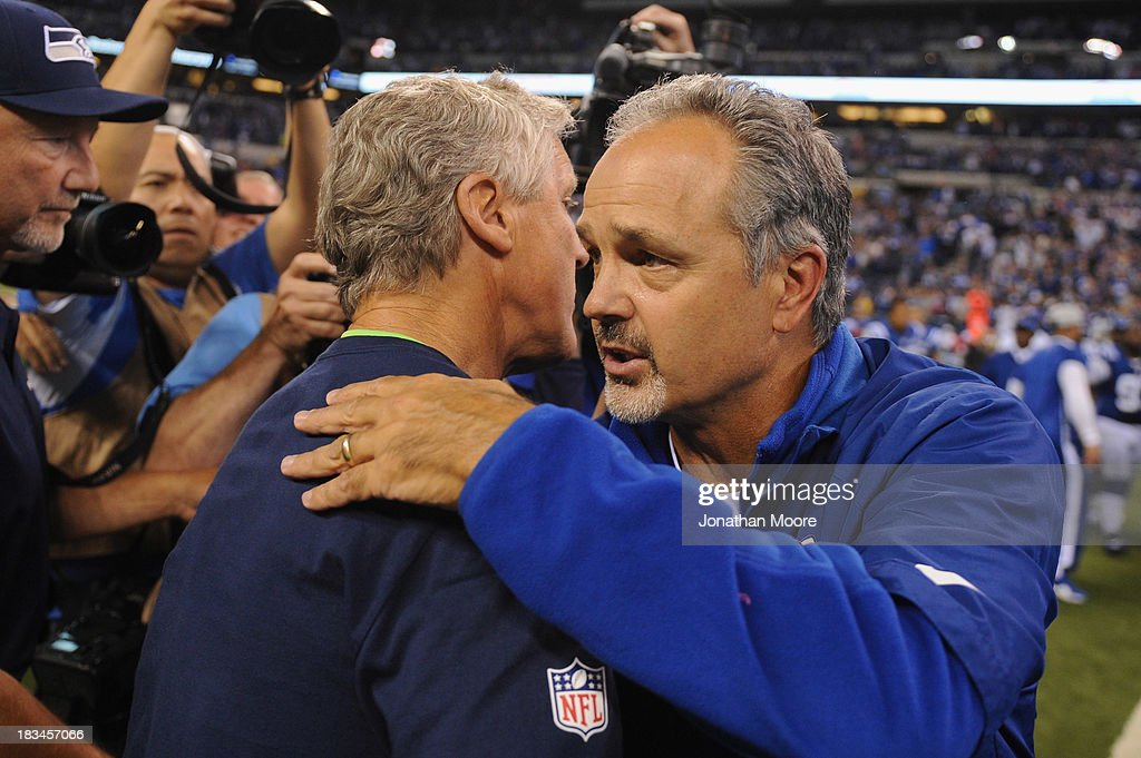 Head Coaches Pete Carroll of the Seattle Seahawks (L) and Chuck Pagano (R) of the Indianapolis Colts shake hands after the Colts beat the Seahawks 28-34 at Lucas Oil Stadium on October 6, 2013 in Indianapolis, Indiana.