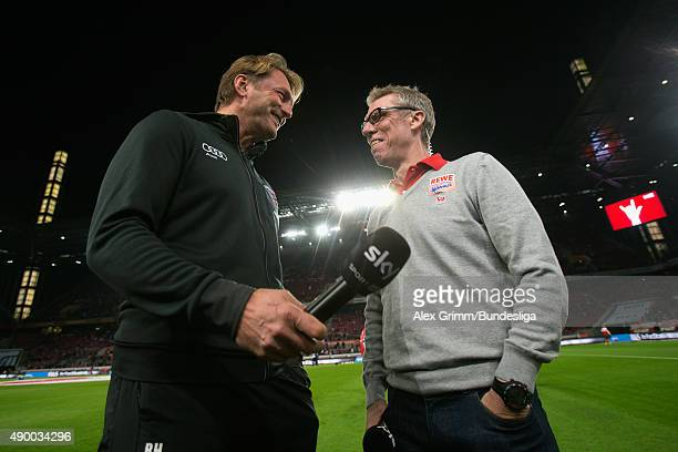 Head coaches Ralph Hasenhuettl of Ingolstadt and Peter Stoeger of Koeln chat prior to the Bundesliga match between 1 FC Koeln and FC Ingolstadt at...