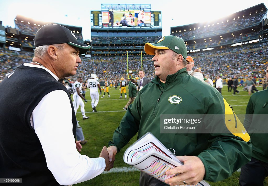 Head coaches Rex Ryan of the New York Jets and Mike McCarthy of the Green Bay Packers shake hands following the NFL game at Lambeau Field on September 14, 2014 in Green Bay, Wisconsin. The Packers defeated the Jets 31-24.