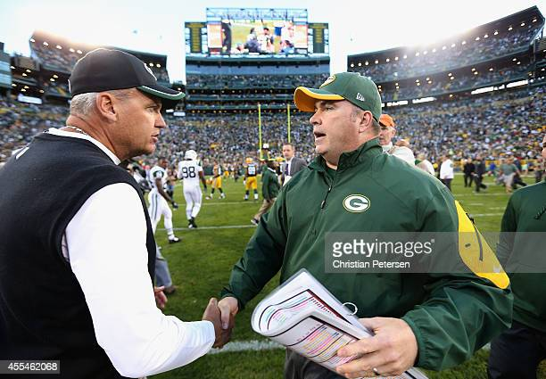 Head coaches Rex Ryan of the New York Jets and Mike McCarthy of the Green Bay Packers shake hands following the NFL game at Lambeau Field on...