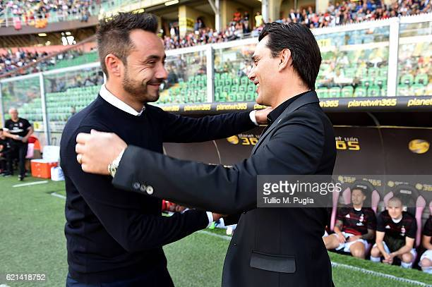 Head coaches Roberto De Zerbi of Palermo and Vincenzo Montella hug each other during the Serie A match between US Citta di Palermo and AC Milan at...