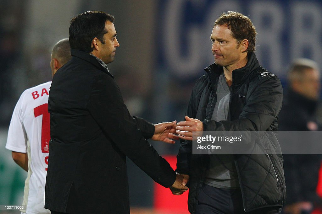 Head coaches Robin Dutt of Leverkusen and Marcus Sorg of Freiburg shake hands after the Bundesliga match between SC Freiburg and Bayer 04 Leverkusen...