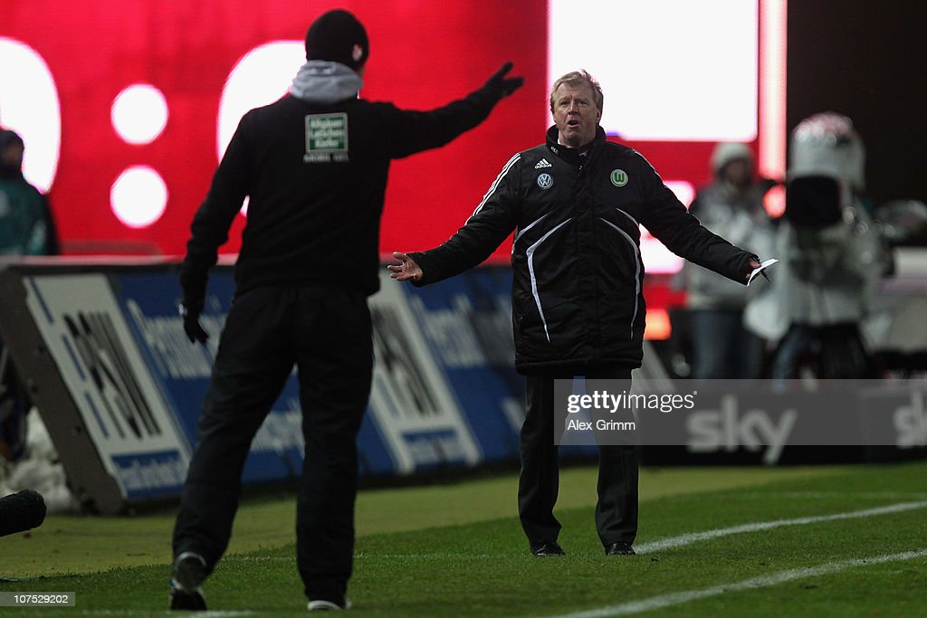 Head coaches Steve McClaren (R) of Wolfsburg and <a gi-track='captionPersonalityLinkClicked' href=/galleries/search?phrase=Marco+Kurz&family=editorial&specificpeople=2383064 ng-click='$event.stopPropagation()'>Marco Kurz</a> (L) of Kaiserslautern argue during the Bundesliga match between 1. FC Kaiserslautern and VfL Wolfsburg at Fritz-Walter-Stadion on December 11, 2010 in Kaiserslautern, Germany.