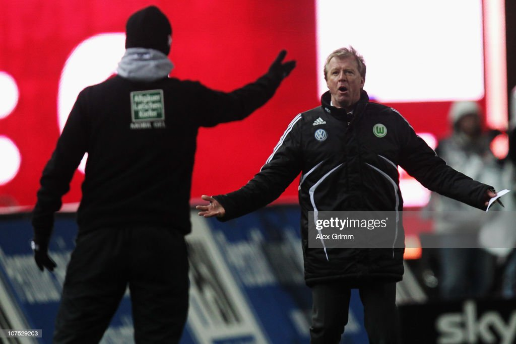 Head coaches Steve McClaren of Wolfsburg and Marco Kurz of Kaiserslautern argue during the Bundesliga match between 1 FC Kaiserslautern and VfL...