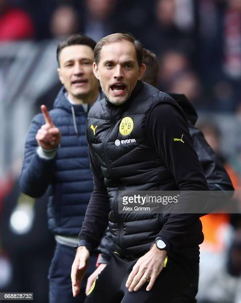 Head coaches Thomas Tuchel of Dortmund and Niko Kovac of Frankfurt argue during the Bundesliga match between Borussia Dortmund and Eintracht...