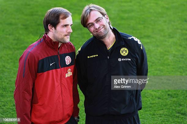 Head coaches Thomas Tuchel of Mainz and Juergen Klopp of Dortmund stand together before the Bundesliga match between FSV Mainz 05 and Borussia...