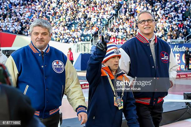 Head Coaches Todd McLellan of the Edmonton Oilers and Paul Maurice of the Winnipeg Jets head to the ice with Oilers dressing room attendant Joey Moss...