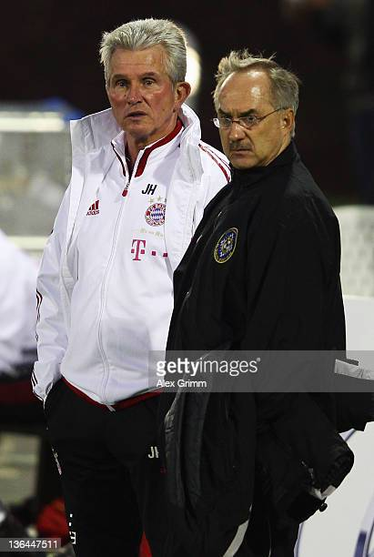 Head coaches Uli Stielike of AlSailiya and Jupp Heynckes of Muenchen chat before their team's international friendly match at the 'ASPIRE Academy for...