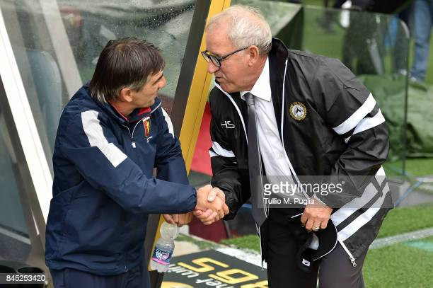 Head coches Ivan Juric of Genoa and Luigi Delneri of Udinese shake hands before the Serie A match between Udinese Calcio and Genoa CFC at Stadio...