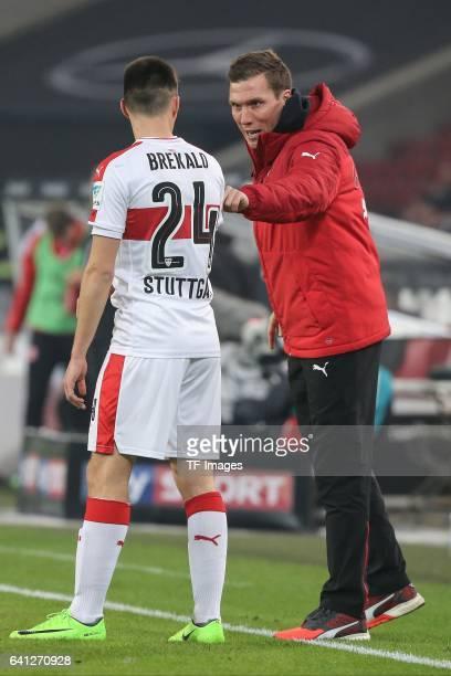 Head couch Hannes Wolf of Stuttgart speak with Josip Brekalo of Stuttgart during the Second Bundesliga match between VfB Stuttgart and Fortuna...