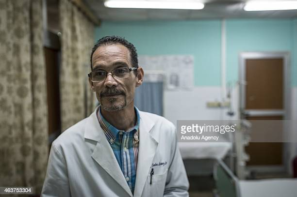 Head doctor of '19 De Abril' hospital ProfDr Carlos Lopez Lima speaks about patients in Havana Cuba on February 12 2015 A Cuban family physician...