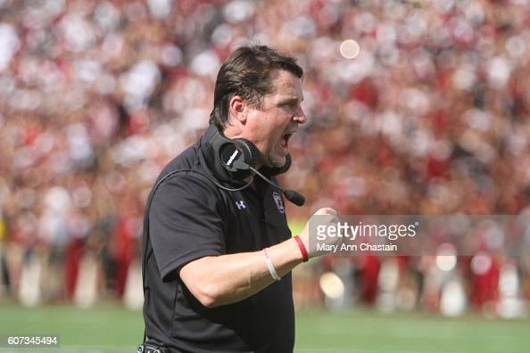 Head Football coach Will Muschamp of the South Carolina Gamecocks celebrates his team during the first quarter of their game against the East...