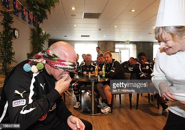Head Groundsman Mick Curran endures some of the bush tucker trails during an Australia themed day at the Newcastle United training ground in Little...