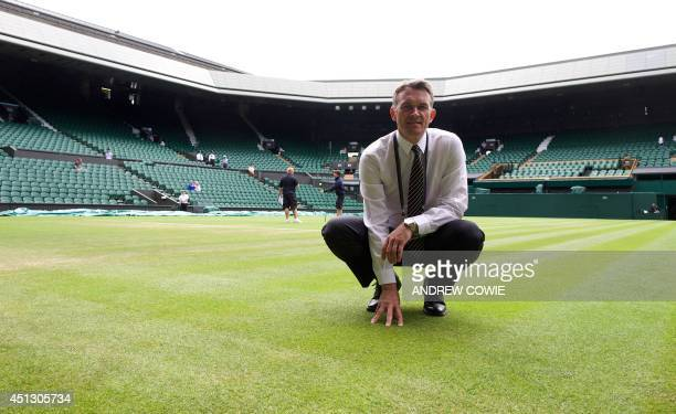 Head groundsman Neil Stubley poses for a picture on the grass of centre court during the 2014 Wimbledon Championships at The All England Tennis Club...