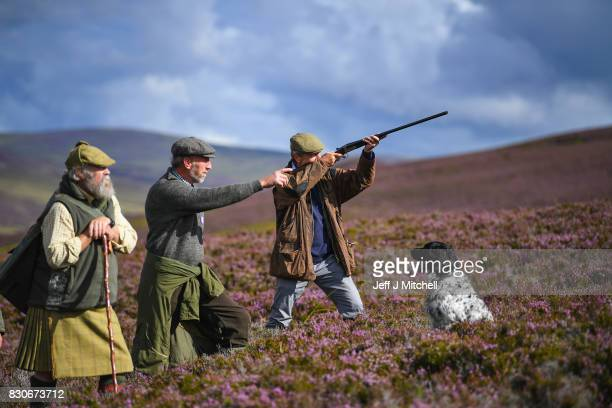 Head keeper Graeme MacDonald leads a shooting party at the beginning of a new shooting season on a grouse moor at the Alvie Estate on August 12 2017...