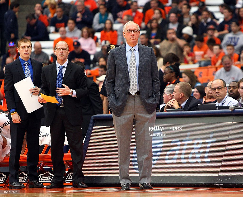 Head manager Kevin Belbey, director of basketball operations Stan Kissel and head coach Jim Boeheim of the Syracuse Orange look on as they stand on the sideline during the win over the Wagner Seahawks during the game at the Carrier Dome on November 18, 2012 in Syracuse, New York.