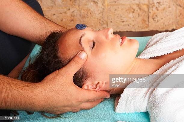 Head massage with hot stone
