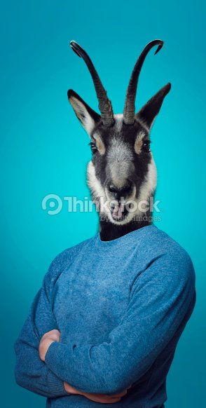 Head of a Goat on a man's body : Stock Photo