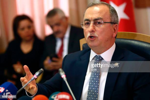Head of a Turkish parliamentary committee Resat Petek gestures as he delivers a speech during a press conference on the investigation of the coup...