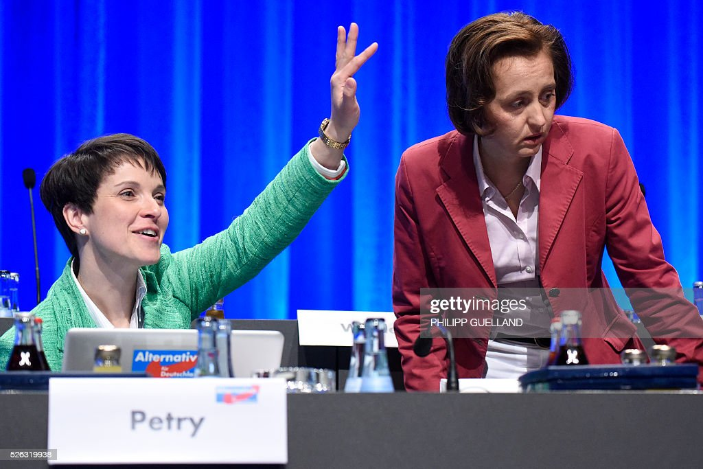 Head of AFD, Frauke Petry (L) and AfD deputy leader Beatrix von Storch attend a party congress of the German right wing party AfD (Alternative fuer Deutschland) at the Stuttgart Congress Centre ICS on April 30, 2016 in Stuttgart, southern Germany. The Alternative for Germany (AfD) party is meeting in the western city of Stuttgart, where it is expected to adopt an anti-Islamic manifesto, emboldened by the rise of European anti-migrant groups like Austria's Freedom Party. / AFP / Philipp GUELLAND